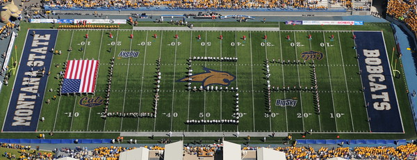 Montana State University Bobcat Stadium first home game, new stadium end zone. Photo of the MSU and Bozeman Hawk Marching Band spelling out U.S.A. with the United States Flag on Bobcat Field. Aerial photo Sept 10th, 2011 by Jim R Harris Bozeman Montana Photographer